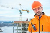 happy builder worker at construction site poster