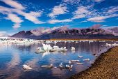 The ice floes and cirrocumulus clouds of lagoon Jokulsarlon, Iceland.  Cirrocumulus magically reflec poster
