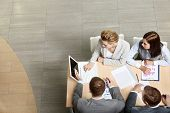 stock photo of business-partner  - Image of business partners sitting at table and planning work - JPG