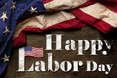US American flag on worn black background. For USA Labor day celebration. With Happy Labor Day text. poster