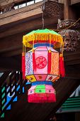 image of woodcarving  - Traditional Chinese lantern hanging in the  wooden building with many chinese old style woodcarving - JPG