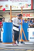 TOA PAYOH, SINGAPORE - MARCH 24 : Contender for Strongman  Yusri Bin Ali attempts the 300kg Yoke wal