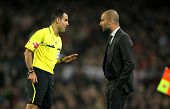 BARCELONA - MARCH 3: Referee Velasco Carballo talks with Pep Guardiola of Barcelona during the Spani