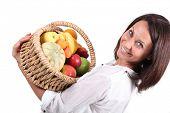 Woman carrying fruit basket