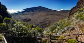 Scenic view of Piton de la Fournaise volcano viewed from the caldera with a track in foreground, Reu