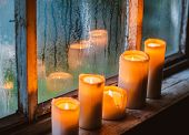 Beautiful Background With Raindrops On The Window And Burning Candles. Twilight Rainy Summer Or Autu poster