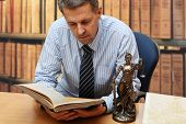 stock photo of metal sculpture  - Lawyer reading a book - JPG