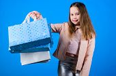 Fashion Shop. Little Girl With Bunch Packages. Happy Child In Shop With Bags. Shopping Day Happiness poster