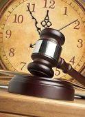 stock photo of magistrate  - Gavel and old clock - JPG