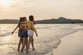 Group Of Three Asian Young Women Walking On Beach, Friends Happy Relax Having Fun Playing On Beach N poster