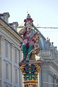 image of ogre  - Famous fountain and statue of ogre eating small children in Bern - JPG