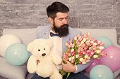 Romantic Gift. Romantic Man With Flowers And Teddy Bear Sit On Couch With Air Balloons Waiting Girlf poster