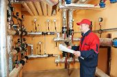 picture of pressure vessel  - maintenance repairman engineer of heating system equipment in a boiler house - JPG