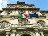 Italian And European Flags On The Facade Of Government Palace Vawing In The Wind poster
