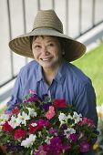 Jardineiro em chapéu de sol