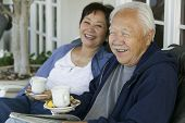 stock photo of early 60s  - Older Couple Drinking Tea - JPG