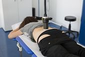 Diamagnetic Pump For Pain Therapy: Woman Lying On Abed Undergoing Therapy. poster