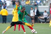 CARSON, CA. - JUNE 6: Jamaica player D Eric Vernan #8 (L) & Grenada player D Anthony Straker #15 (R) in action during the 2011 CONCACAF Gold Cup group B game on June 6 2011 at the Home Depot Center in Carson, CA.