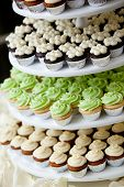 mini cupcakes on a multi level tier in different colors