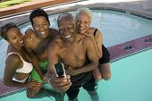 Family Posing for Camera Phone Picture in Pool