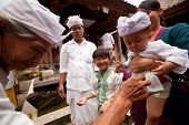 BALI, INDONESIA - MARCH 28: Unidentified child during the ceremonies of Oton - is the first ceremony