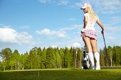 image of ladies golf  - Young blonde  woman with golf equipment - JPG