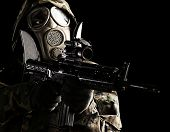 picture of gas mask  - soldier with camouflage coat - JPG