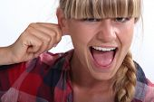 Woman pinching an ear