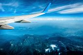 Wing Of Airplane Flying Above Alps poster