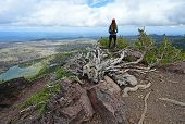 Female Hiker Enjoying The View From The Tam Mcarthur Rim Trail In The Three Sisters Wilderness Near  poster