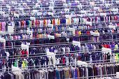 Large clothing store, many rows with hangers, variety of sizes