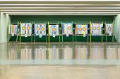 Colorful targets for archery with holes from arrows inside shooting range