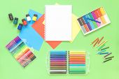 Assorted Office Or School Sets Of Multicolored Rainbow Stationery Markers On Pastel Green Background poster