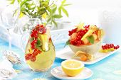 Delicious fresh fruits served in melon bowl as dessert with lemonade