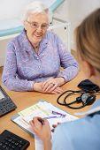 Senior woman patient with UK nurse