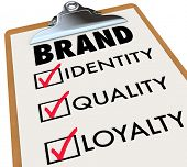 The word brand and its core characteristics such as Identity, Quality and Loyalty written on a checklist on a clipboard to illustrate what you need to do to build your reputation among customers