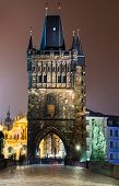 Stare Mesto Tower From The Charles Bridge At Night, Prague.