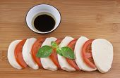 mozzarella on chopping board with tomato basil