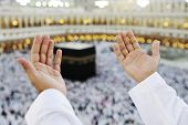 stock photo of mekah  - Muslim Arabic man praying at Kaaba in Mecca - JPG