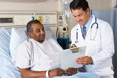 stock photo of geriatric  - Doctor Explaining Consent Form To Senior Patient - JPG