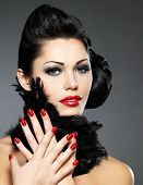 stock photo of nail-design  - Beautiful fashion woman with red nails creative hairstyle and makeup  - JPG