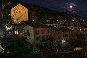 Cloudy Full Moon Over Cortona, Italy