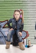 foto of rap-girl  - a young girl listening to rap music and rapper clothes - JPG