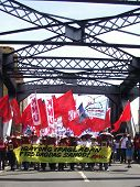 Banners Of Protest At A Metal Bridge