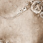 picture of rusty-spotted  - vintage textured background with a bouquet of flowers lace and pearls - JPG