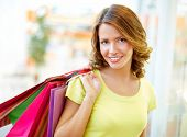 stock photo of flirty  - Portrait of a shopping girl with flirty look - JPG