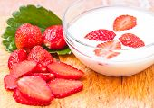 picture of beaker  - the Yogurt in Beaker with Fresh Organic strawberries - JPG