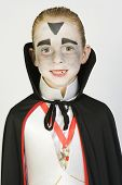 stock photo of preteen  - Portrait of a preteen Caucasian boy in vampire costume isolated over white background - JPG