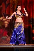 MOSCOW - JAN 28: Participant of Bellydance Superiority of Moscow in blue-gold suit dances on stage o