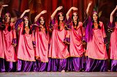 MOSCOW - JAN 28: Women dancing collective dressed in oriental dress  on stage of Red October Culture